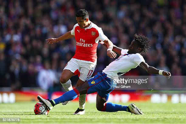 Alexis Sanchez of Arsenal is tackled by Pape N'Diaye Souare of Crystal Palace during the Barclays Premier League match between Arsenal and Crystal...