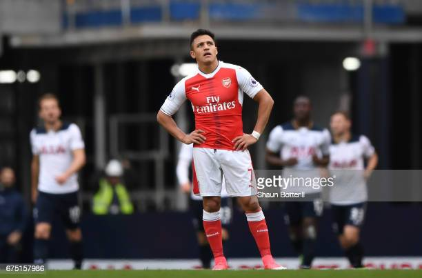 Alexis Sanchez of Arsenal looks dejected after Tottenham Hotspur first goal during the Premier League match between Tottenham Hotspur and Arsenal at...