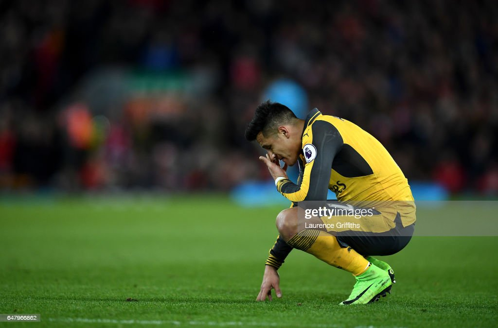 Alexis Sanchez of Arsenal looks dejected during the Premier League match between Liverpool and Arsenal at Anfield on March 4, 2017 in Liverpool, England.