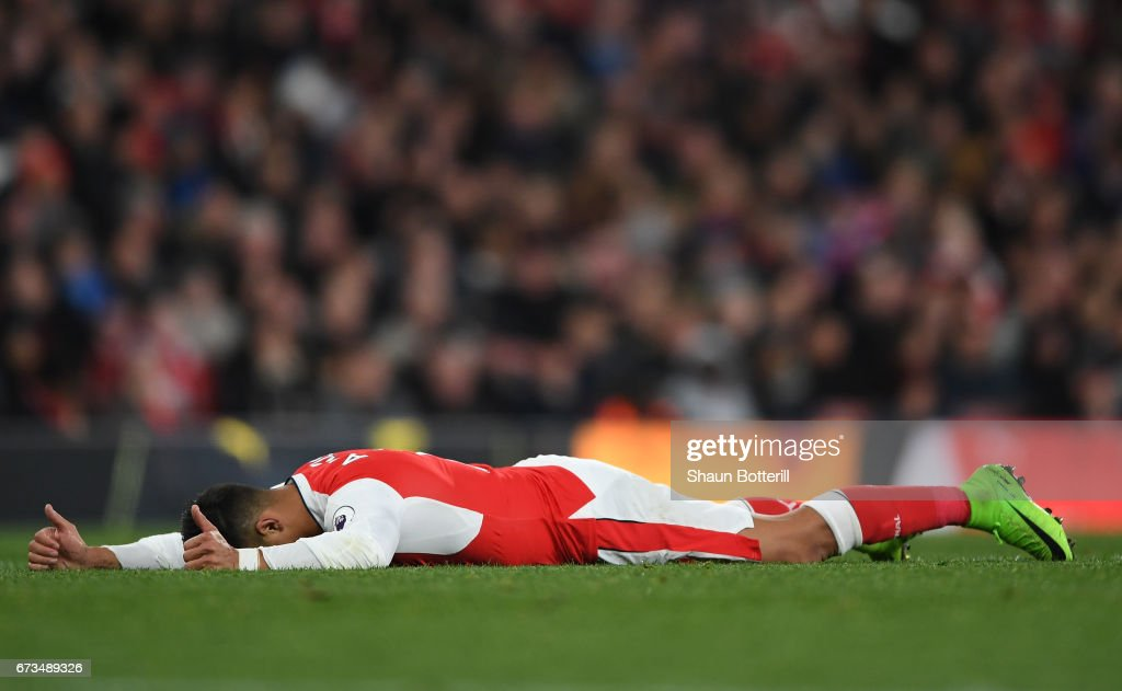 Alexis Sanchez of Arsenal looks dejected during the Premier League match between Arsenal and Leicester City at the Emirates Stadium on April 26, 2017 in London, England.