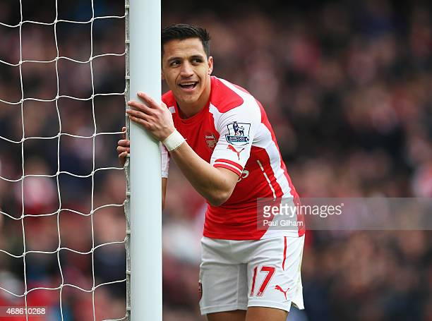 Alexis Sanchez of Arsenal looks on during the Barclays Premier League match between Arsenal and Liverpool at Emirates Stadium on April 4 2015 in...