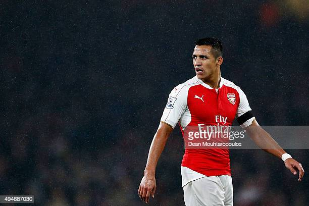 Alexis Sanchez of Arsenal looks on during the Barclays Premier League match between Arsenal and Everton at Emirates Stadium on October 24 2015 in...