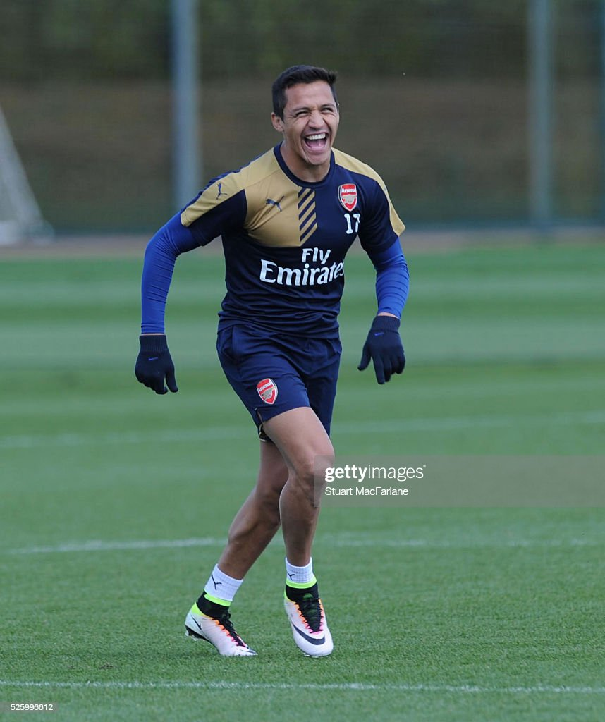 <a gi-track='captionPersonalityLinkClicked' href=/galleries/search?phrase=Alexis+Sanchez&family=editorial&specificpeople=5515162 ng-click='$event.stopPropagation()'>Alexis Sanchez</a> of Arsenal racts during a training session at London Colney on April 29, 2016 in St Albans, England.
