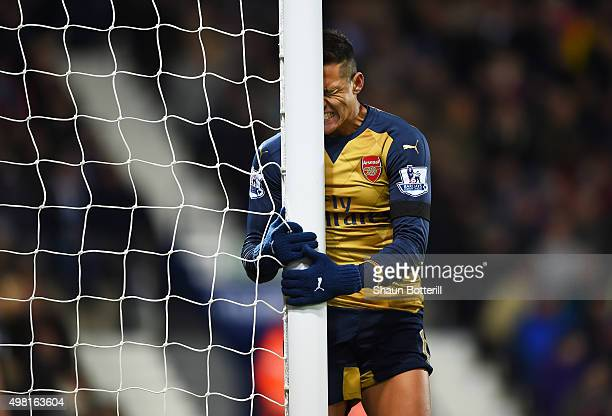 Alexis Sanchez of Arsenal reacts after missing a chance during the Barclays Premier League match between West Bromwich Albion and Arsenal at The...