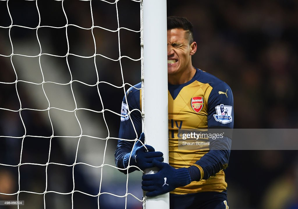 <a gi-track='captionPersonalityLinkClicked' href=/galleries/search?phrase=Alexis+Sanchez&family=editorial&specificpeople=5515162 ng-click='$event.stopPropagation()'>Alexis Sanchez</a> of Arsenal reacts after missing a chance during the Barclays Premier League match between West Bromich Albion and Arsenal at The Hawthorns on November 21, 2015 in West Bromwich, England.