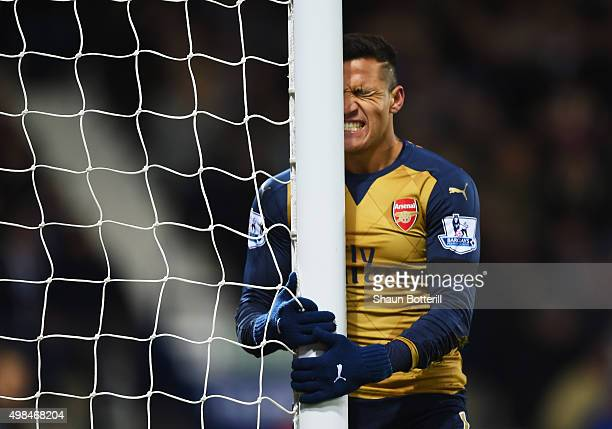 Alexis Sanchez of Arsenal reacts after missing a chance during the Barclays Premier League match between West Bromich Albion and Arsenal at The...