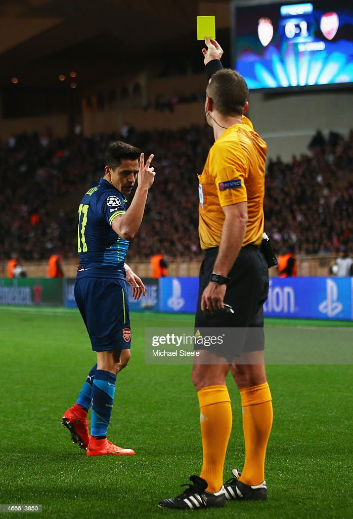 <a gi-track='captionPersonalityLinkClicked' href=/galleries/search?phrase=Alexis+Sanchez&family=editorial&specificpeople=5515162 ng-click='$event.stopPropagation()'>Alexis Sanchez</a> of Arsenal reacts as he is shown a yellow card by referee <a gi-track='captionPersonalityLinkClicked' href=/galleries/search?phrase=Svein+Oddvar+Moen&family=editorial&specificpeople=6489051 ng-click='$event.stopPropagation()'>Svein Oddvar Moen</a> during the UEFA Champions League round of 16 second leg match between AS Monaco and Arsenal at Stade Louis II on March 17, 2015 in Monaco, Monaco.