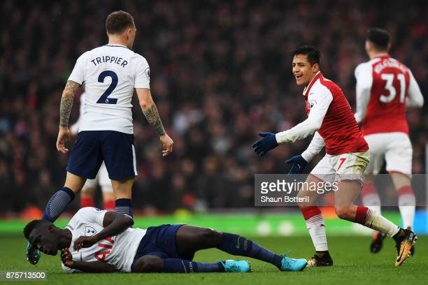 Alexis Sanchez of Arsenal reacts during the Premier League match between Arsenal and Tottenham Hotspur at Emirates Stadium on November 18 2017 in...