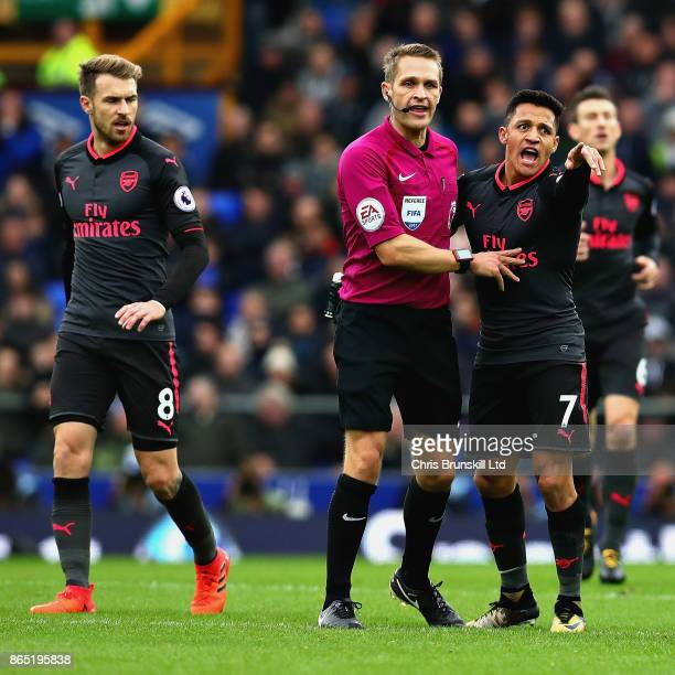 Alexis Sanchez of Arsenal reacts to a decision by Referee Craig Pawson during the Premier League match between Everton and Arsenal at Goodison Park...