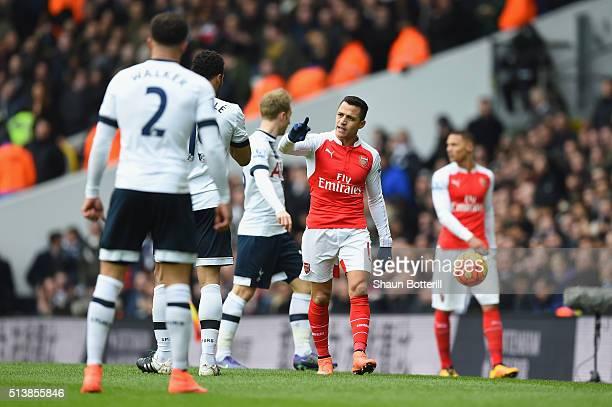 Alexis Sanchez of Arsenal reacts towards Mousa Dembele of Tottenham Hotspur during the Barclays Premier League match between Tottenham Hotspur and...
