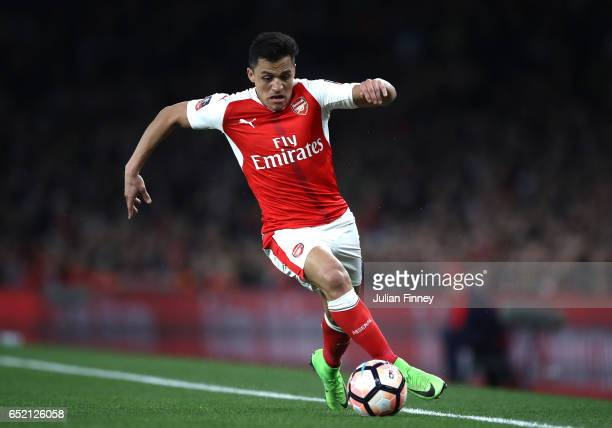 Alexis Sanchez of Arsenal runs with the ball during The Emirates FA Cup QuarterFinal match between Arsenal and Lincoln City at Emirates Stadium on...