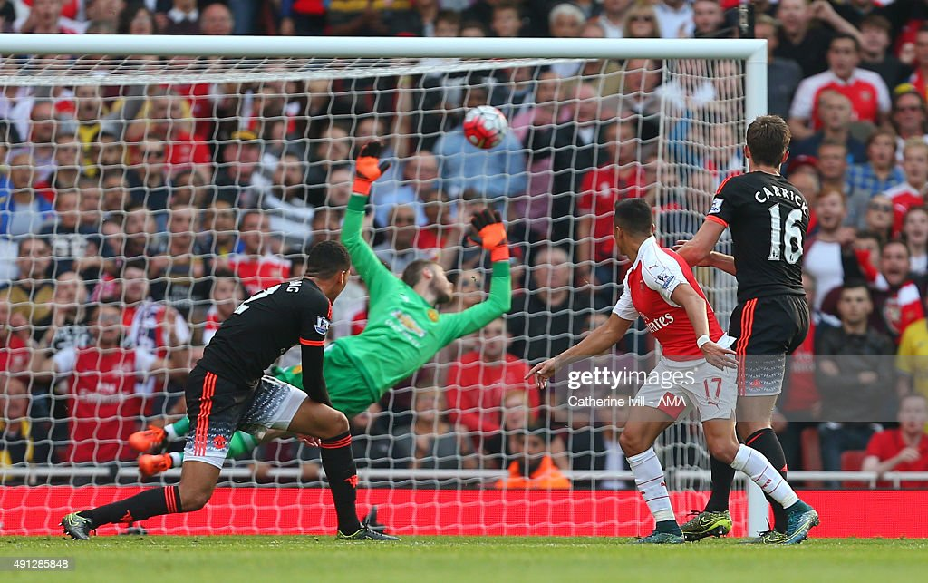 Alexis Sanchez of Arsenal scores a goal to make it 3-0 during the Barclays Premier League match between Arsenal and Manchester United at the Emirates Stadium on October 04, 2015 in London, United Kingdom.