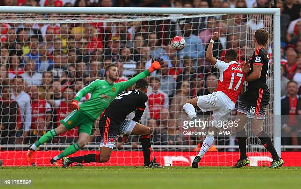 Alexis Sanchez of Arsenal scores a goal to make it 30 during the Barclays Premier League match between Arsenal and Manchester United at the Emirates...
