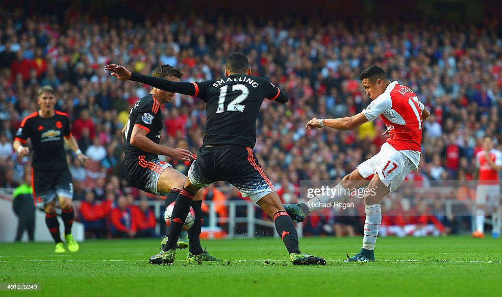 Alexis Sanchez of Arsenal scores arsenal's 3rd goal during the Barclays Premier League match between Arsenal and Manchester United at Emirates Stadium on October 4, 2015 in London, England.