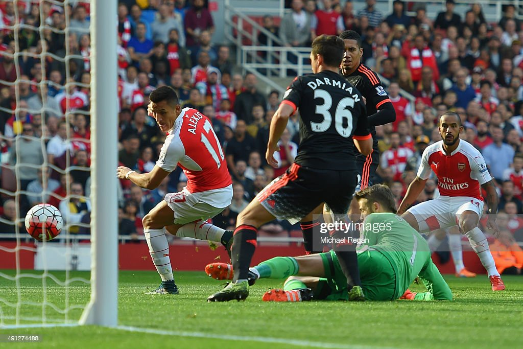 Alexis Sanchez of Arsenal scores Arsenal's first goal during the Barclays Premier League match between Arsenal and Manchester United at Emirates Stadium on October 4, 2015 in London, England.