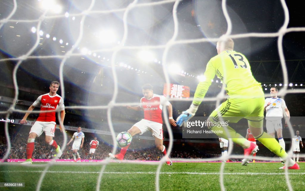 Alexis Sanchez of Arsenal scores his sides first goal past Jordan Pickford of Sunderland during the Premier League match between Arsenal and Sunderland at Emirates Stadium on May 16, 2017 in London, England.