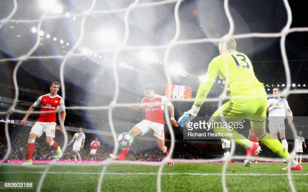 Alexis Sanchez of Arsenal scores his sides first goal past Jordan Pickford of Sunderland during the Premier League match between Arsenal and...