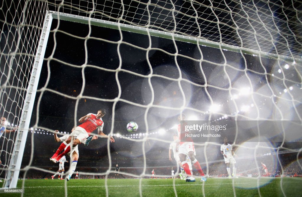 Alexis Sanchez of Arsenal scores his sides second goal during the Premier League match between Arsenal and Sunderland at Emirates Stadium on May 16, 2017 in London, England.