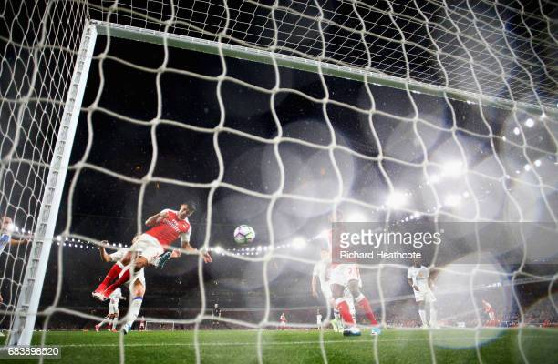 Alexis Sanchez of Arsenal scores his sides second goal during the Premier League match between Arsenal and Sunderland at Emirates Stadium on May 16...