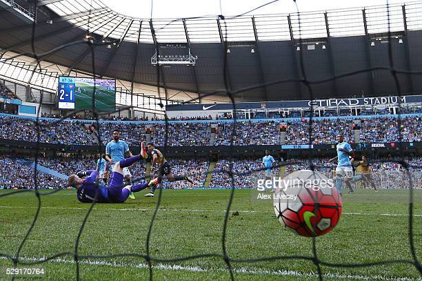 Alexis Sanchez of Arsenal scores his side's second goal past Joe Hart of Manchester City during the Barclays Premier League match between Manchester...