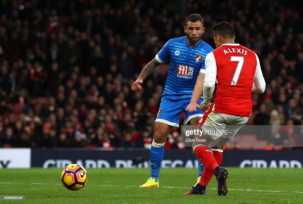 Alexis Sanchez of Arsenal (R) scores his sides third goal during the Premier League match between Arsenal and AFC Bournemouth at Emirates Stadium on November 27, 2016 in London, England.