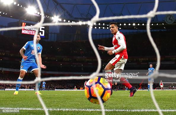 Alexis Sanchez of Arsenal scores his sides third goal during the Premier League match between Arsenal and AFC Bournemouth at Emirates Stadium on...