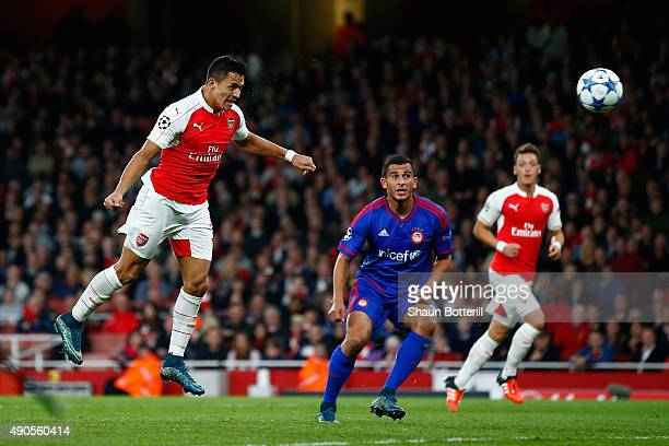 Alexis Sanchez of Arsenal scores his teams second goal with a header during the UEFA Champions League Group F match between Arsenal FC and Olympiacos...