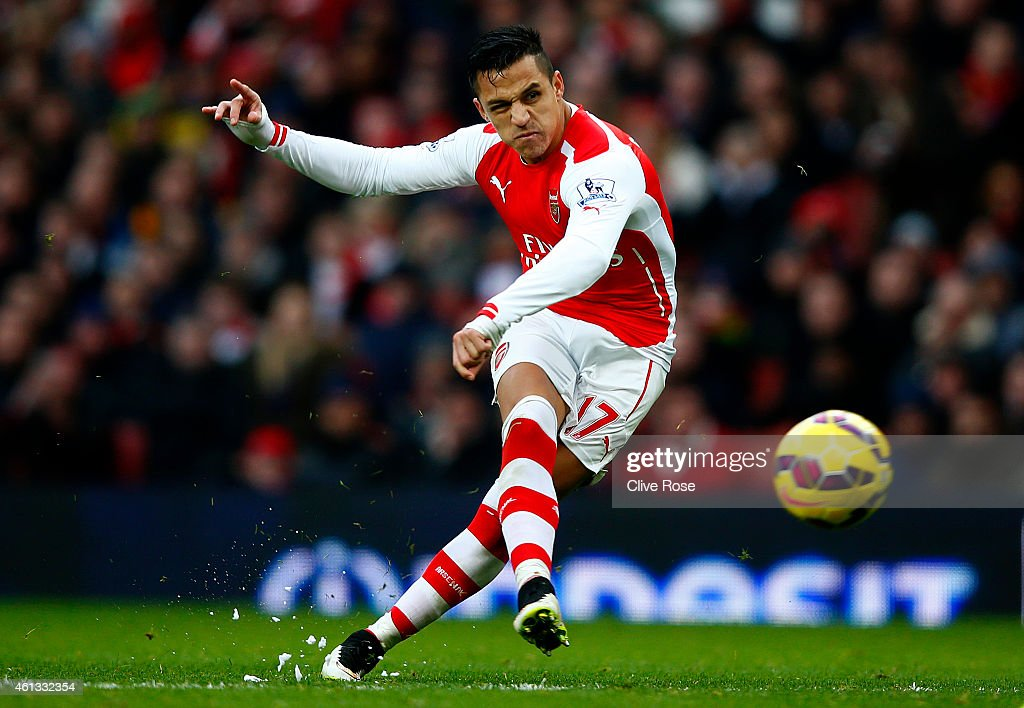 Alexis Sanchez of Arsenal scores his team's third goal during the Barclays Premier League match between Arsenal and Stoke City at Emirates Stadium on January 11, 2015 in London, England.