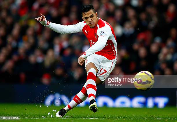 Alexis Sanchez of Arsenal scores his team's third goal during the Barclays Premier League match between Arsenal and Stoke City at Emirates Stadium on...