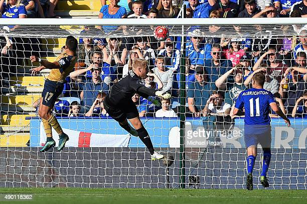 Alexis Sanchez of Arsenal scores his team's third goal during the Barclays Premier League match between Leicester City and Arsenal at The King Power...