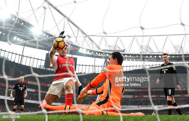 Alexis Sanchez of Arsenal scores the opening goal during the Premier League match between Arsenal and Hull City at Emirates Stadium on February 11...