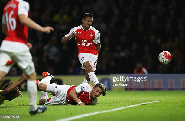 Alexis Sanchez of Arsenal scores their first goal during the Barclays Premier League match between Watford and Arsenal at Vicarage Road on October 17...