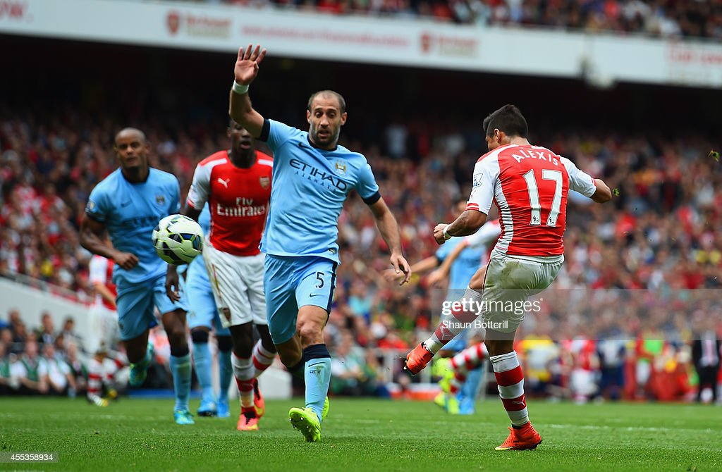 Alexis Sanchez of Arsenal scores their second goal during the Barclays Premier League match between Arsenal and Manchester City at Emirates Stadium on September 13, 2014 in London, England.