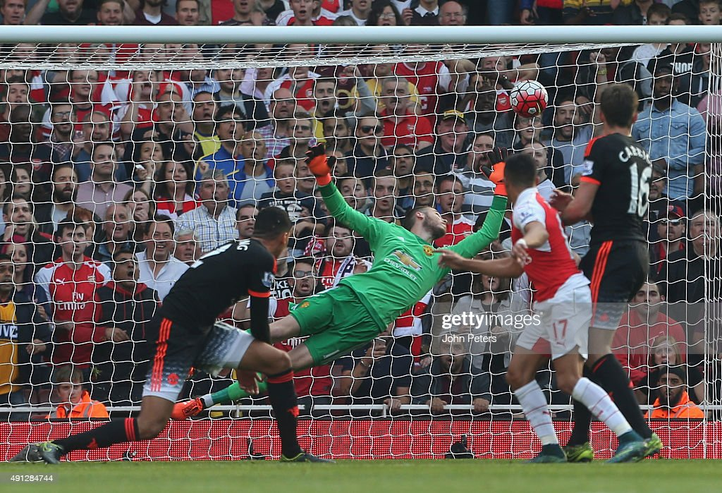 Alexis Sanchez of Arsenal scores their third goal during the Barclays Premier League match between Arsenal and Manchester United at Emirates Stadium on October 4, 2015 in London, England