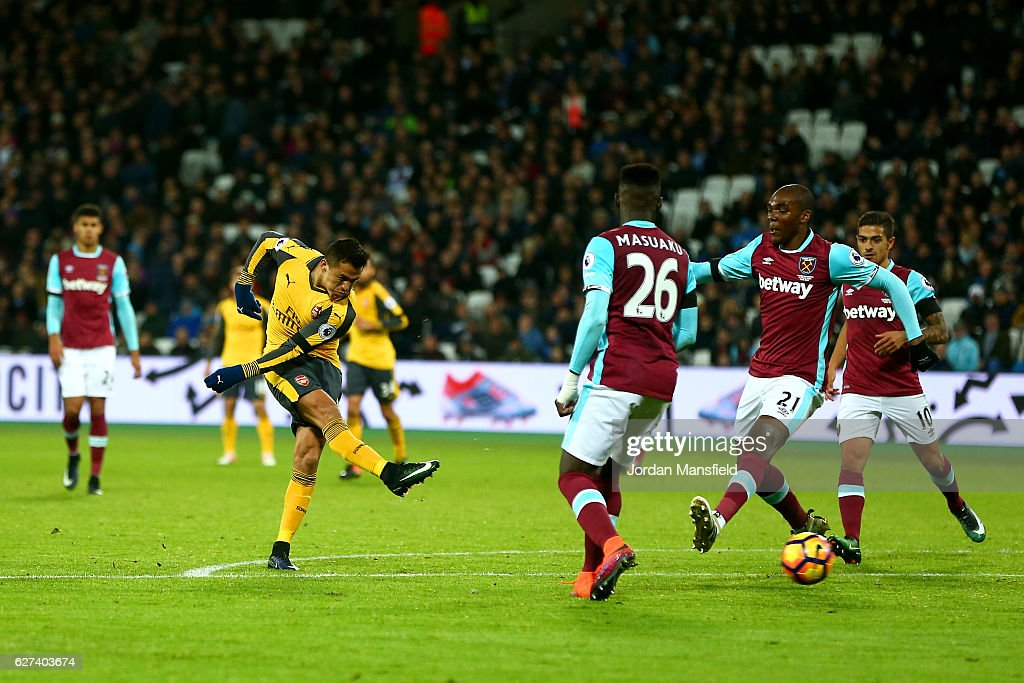 Alexis Sanchez of Arsenal scores their third goal during the Premier League match between West Ham United and Arsenal at London Stadium on December 3, 2016 in London, England.
