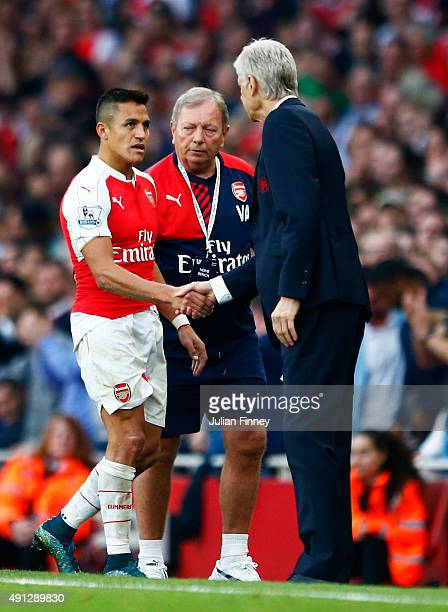 Alexis Sanchez of Arsenal shakes hands with Arsene Wenger manager of Arsenal as he is substituted during the Barclays Premier League match between...