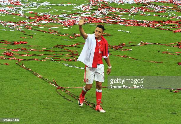 Alexis Sanchez of Arsenal shows appreciation to the fans after the Emirates FA Cup Final between Arsenal and Chelsea at Wembley Stadium on May 27...