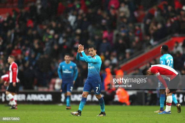 Alexis Sanchez of Arsenal shows appreciation to the fans following the Premier League match between Southampton and Arsenal at St Mary's Stadium on...