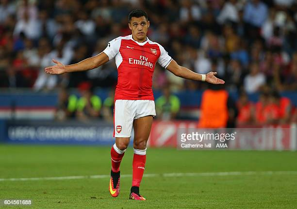 Alexis Sanchez of Arsenal shrugs his shoulders during the UEFA Champions League match between Paris SaintGermain and Arsenal at Parc des Princes on...