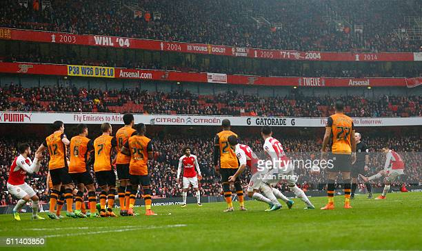 Alexis Sanchez of Arsenal takes a free kick during the Emirates FA Cup fifth round match between Arsenal and Hull City at the Emirates Stadium on...