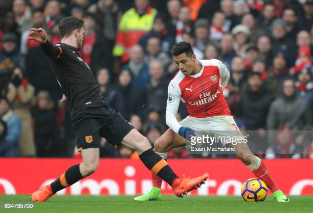 Alexis Sanchez of Arsenal takes on Andrew Robertson of Hull during the Premier League match between Arsenal and Hull City at Emirates Stadium on...