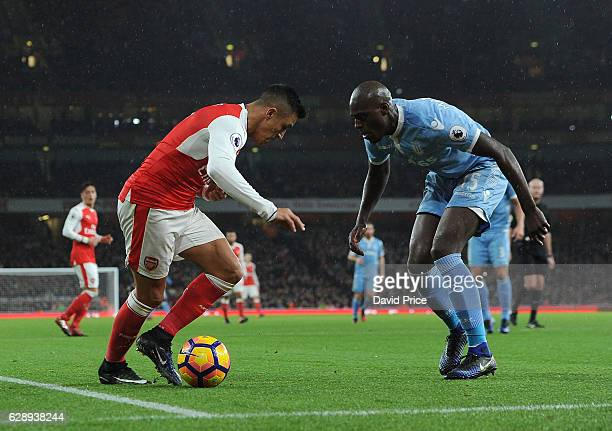 Alexis Sanchez of Arsenal takes on Bruno Martins Indi of Stoke during the Premier League match between Arsenal and Stoke City at Emirates Stadium on...