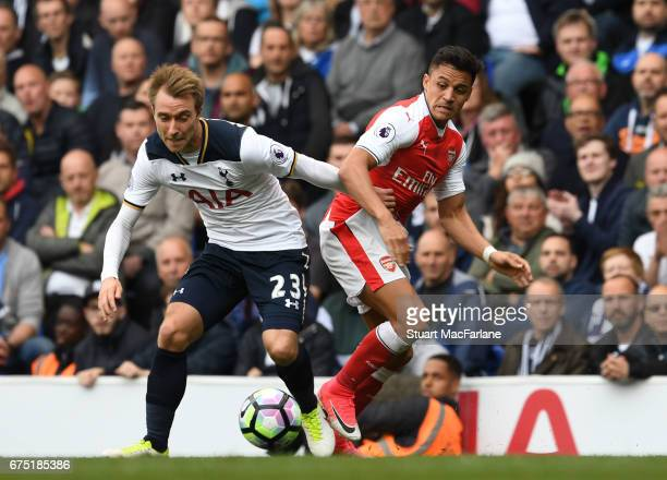 Alexis Sanchez of Arsenal takes on Christian Eriksen of Tottenham during the Premier League match between Tottenham Hotspur and Arsenal at White Hart...