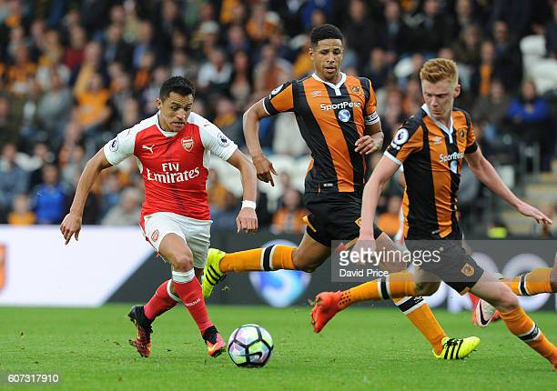Alexis Sanchez of Arsenal takes on Curtis Davies and Sam Clucas of Hull during the Premier League match between Hull City and Arsenal at KCOM Stadium...
