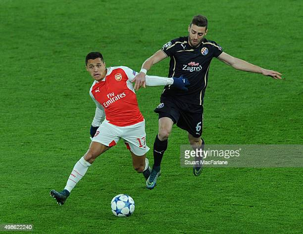 Alexis Sanchez of Arsenal takes on Ivo Pinto of Zagreb during the UEFA Champions League Group Stage match between Arsenal and Dinamo Zagreb on...