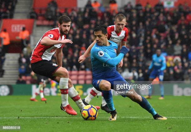 Alexis Sanchez of Arsenal takes on Jack Stephens of Southampton during the Premier League match between Southampton and Arsenal at St Mary's Stadium...