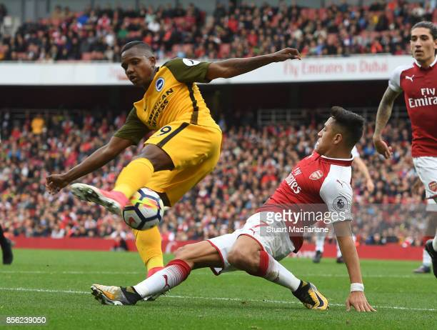 Alexis Sanchez of Arsenal takes on Jose Izquierdo of Brighton during the Premier League match between Arsenal and Brighton and Hove Albion at...