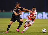 Alexis Sanchez of Arsenal takes on Marko Pjaca of Dinamo during the match between GNK Dinamo Zagreb and Arsenal on September 16 2015 in Zagreb Croatia