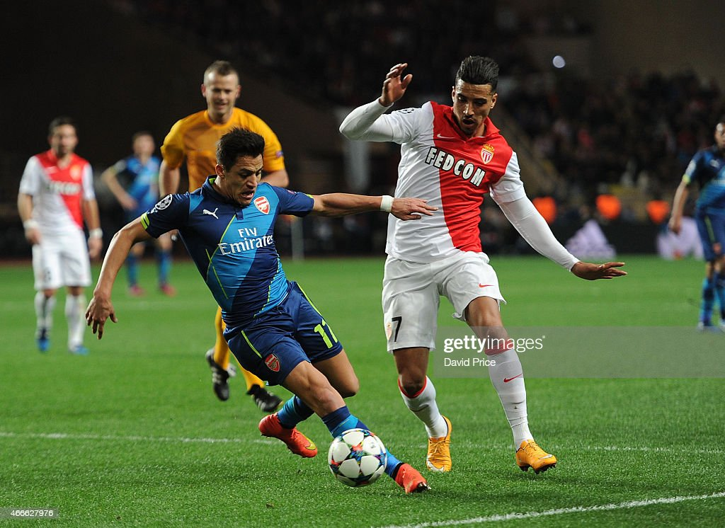 Alexis Sanchez of Arsenal takes on Nabil Dirar of Monaco during the match between AS Monaco and Arsenal at Stade Louis II on March 17, 2015 in Monaco, Monaco.