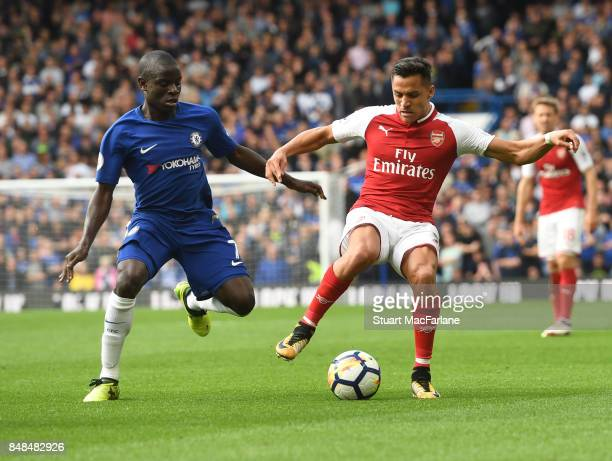 Alexis Sanchez of Arsenal takes on N'Golo Kante of Chelsea during the Premier League match between Chelsea and Arsenal at Stamford Bridge on...